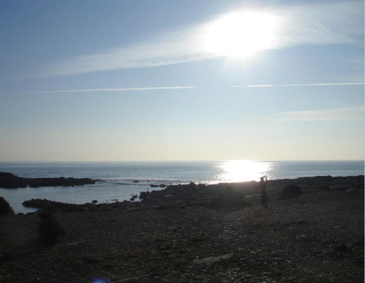 La plage devant le phare